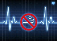 Stop smoking sign on blue heart rate monitor